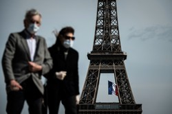 Paris adota uso obrigatório de máscara; EUA superam cinco milhões de casos (Foto: PHILIPPE LOPEZ / AFP)