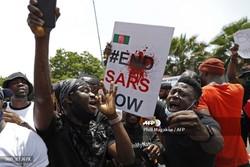 Após dia de morte e violência na Nigéria, toque de recolher continua em Lagos (Foto: PHILL MAGAKOE / AFP)