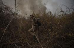 Incêndios no Pantanal causam fenômeno de chuva escura no Sul do país (Foto: MAURO PIMENTEL / AFP  )