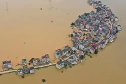 Inundações deixam 141 mortos ou desaparecidos na China e ameaçam Wuhan (Foto: STR / AFP)