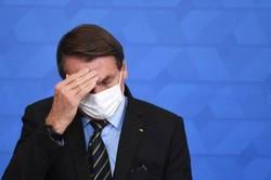 'Não temos culpa de nada', diz Bolsonaro sobre crimes apontados pela CPI (Foto: Evaristo Sa/AFP)