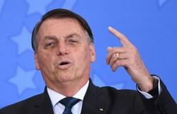 Em Alagoas, Bolsonaro incita coro de apoiadores: 'Renan, vagabundo' (crédito: EVARISTO SA/AFP )