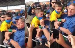 Vídeo: Bolsonaro tira máscara de criança ao pegá-la no colo (Foto: Redes Sociais/Reprodução)