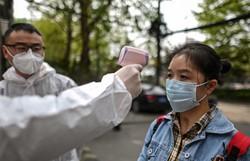 Quarentena chega ao fim em Wuhan, mas normalidade está longe de voltar (Foto: Hector RETAMAL / AFP)
