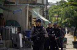 Laudo sobre morto em Jacarezinho mostra ferimento à pouca distância (Foto: Mauro Pimentel/AFP)
