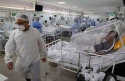 Mundo soma mais de 100 milhões de casos do novo coronavírus (Foto: MICHAEL DANTAS / AFP)