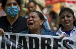 'Onde estão nossos filhos?!', gritam mulheres no Dia das Mães no México (Foto: Ronaldo Schemidt/AFP)