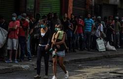 Colômbia supera pela primeira vez os 400 mortos por Covid em 24 horas (Foto: JOAQUIN SARMIENTO / AFP )