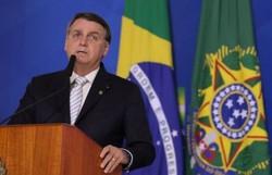 """Bolsonaro: Forças Armadas são """"oxigênio"""" do país e bandeira não mudará de cor (Foto: Clauber Cleber Caetano/PR)"""