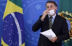 Coronavírus: Bolsonaro anuncia edição de quatro medidas provisórias (Foto: Sérgio Lima / AFP)