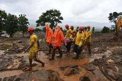 Ao menos 113 morrem no leste da Índia por chuvas torrenciais (Foto: INDRANIL MUKHERJEE / AFP)