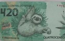 Polícia prende traficante com nota falsa de R$ 420 ilustrada por preguiça (Foto: Divulgação/Deinter 8 - dss (c))