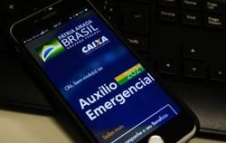 Caixa paga hoje 3ª parcela do auxílio para nascidos em março (Foto: Marcello Casal Jr/Agência Brasil)