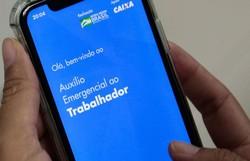 Caixa libera saque da 2ª parcela de auxílio para nascidos em maio (Foto: Marcello CasalJr/Agência Brasil)