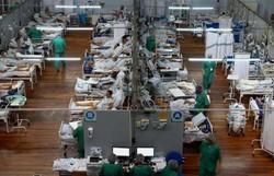 Brasil reduz média de mortes por Covid-19, mas infecções ainda são altas (Foto: AFP / Miguel SCHINCARIOL)