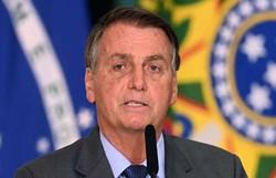 Bolsonaro impõe sigilo de 100 anos aos crachás de acesso dos filhos (EVARISTO SA/AFP)