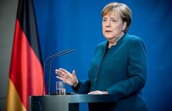 Símbolo da moderação, era Merkel se encerra com eleição apertada (Foto: Michael Kappeler/AFP )