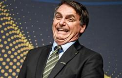 """Bolsonaro provoca Bonner: """"Conseguimos os insumos da China e as vacinas da Índia"""" (Foto: Mauro Pimentel/AFP)"""