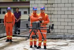 China usa drones e bananas para levar elefantes de volta para casa (Foto: Hector RETAMAL / AFP)