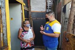 Recife distribui máscaras e kits de higiene nas palafitas do Pina (Foto: PCR/Divulgação.)