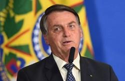 "Bolsonaro ironiza alta cúpula: ""Dormem de máscara mas pegaram o vírus"" (Foto: Evaristo Sá/AFP )"