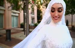 Noiva é surpreendida com explosões em Beirute durante ensaio fotográfico (Foto: Mahmoud Nakib/Reprodução)