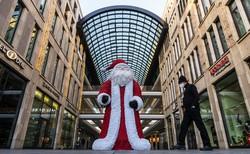 Na Alemanha, os mercados de Natal se adaptam à pandemia (Foto: John MACDOUGALL / AFP)
