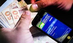 Caixa paga 2ª parcela de R$ 300 da extensão do auxílio emergencial (Foto: Marcello Casal Jr. / Agência Brasil)
