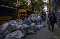 Lixo se acumula em Nova York em protesto contra exigência de vacina contra Covid-19 (Foto: Ed JONES / AFP )