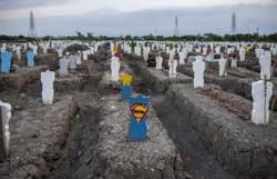 Covid-19: mais de 993 mil mortos no mundo, aponta AFP (Foto: Juni Kriswanto/AFP)