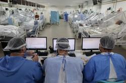 Com mais 858 mortes, Brasil ultrapassa 135 mil vítimas pela Covid-19 (Foto: MICHAEL DANTAS / AFP)