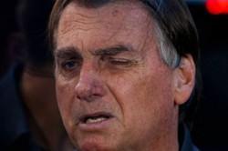 Bolsonaro: 'Não sei se vou disputar as eleições do ano que vem' (Foto: Miguel Schincariol/AFP)