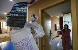 Coronavírus pode deixar sequelas em pacientes com sintomas leves ou curados  (STR/AFP)