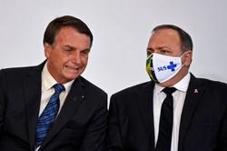 """""""Não pode um juiz decidir se você toma ou não a vacina"""", diz Bolsonaro (Foto: Evaristo Sá/AFP)"""