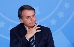 """Bolsonaro pede à população que tome """"banhos rápidos"""" para poupar energia (Foto: Arquivo/ AFP)"""