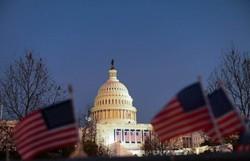 Biden presta homenagem em Washington aos 400 mil mortos pela Covid-19 nos EUA (Foto: ROBERTO SCHMIDT / AFP)