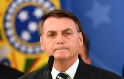 'Responsabilidade é de quem suspendeu o sigilo', diz Bolsonaro sobre vídeo (Foto: AFP )