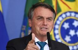 Bolsonaro ataca Renan Calheiros, relator da CPI: 'Vagabundo é elogio para ele' (Foto: Evaristo Sá/AFP)