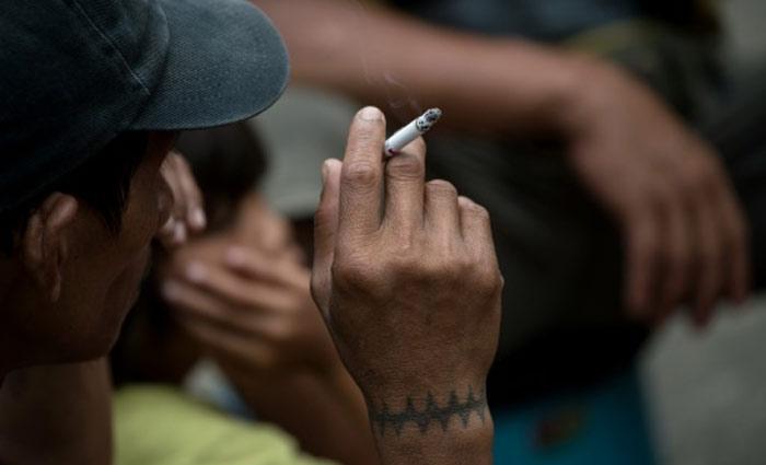 Fumar um maço de cigarros por dia provoca, em média, 150 mutações por ano nas células pulmonares. Foto: Noel Celis/AFP/Arquivos
