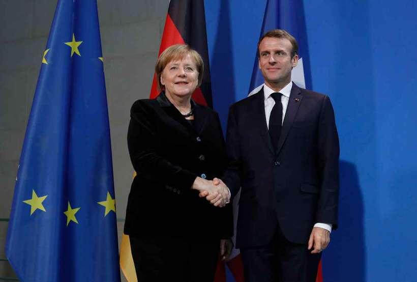 O texto foi assinado por Merkel e pelo presidente francês, Emmanuel Macron, esta manhã, em Aachen, na Alemanha, a quatro meses das eleições legislativas europeias. Foto: Odd Andersen / AFP