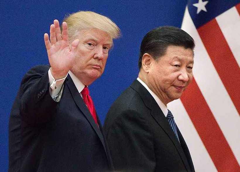 Nas conversações, as duas maiores potências econômicas mundiais disputam a posição dominante nas futuras indústrias de alta tecnologia. Foto: Nicolas ASFOURI / AFP