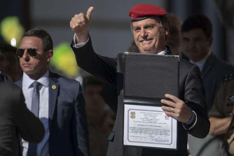 A intenção é que Bolsonaro receba o prêmio de personalidade do ano na cidade localizada no Estado do Texas, mas a transferência do evento ainda depende de tratativas. Foto: Mauro Pimentel/AFP