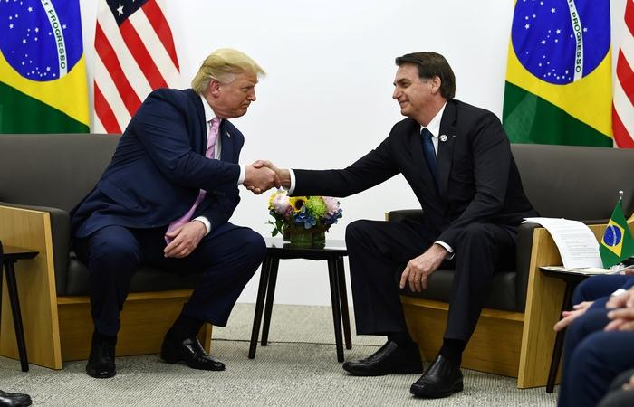 Bolsonaro disse que uma visita de Trump ao Brasil seria 'motivo de orgulho' para o país. Foto: Brendan Smialowski / AFP