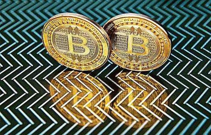 Para especialistas, o bitcoin é uma moeda virtual para quem está preparado para enfrentar fortes variações. Foto: Karen Bleier/AFP