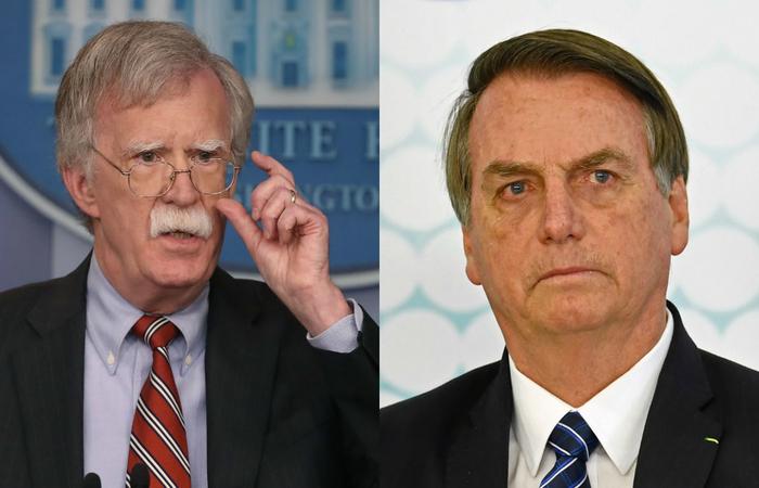 John Bolton, ex-assessor de segurança nacional nos EUA e o presidente Jair Bolsonaro - Créditos: AFP.