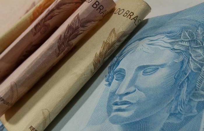 Aproximadamente 81 milhões de brasileiros serão beneficiados com rendimento adicional, em média, de R$ 2.451. (Foto: Marcos Santos/USP Imagens)