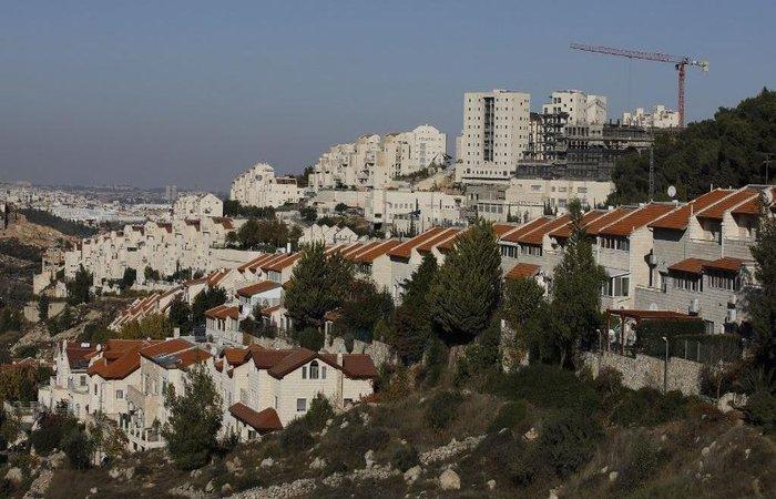Atualmente, mais de 600.000 israelenses coexistem em conflito com cerca de três milhões de palestinos.  (Foto: Menahem Kahana/AFP)