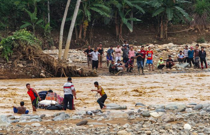Chuvas inundaram mais de 160 bairros e causaram deslizamentos. (Foto: Sammy/AFP)