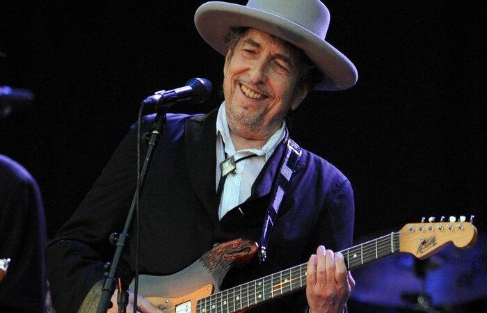 Bob Dylan é considerado uma lenda da música folk (Foto: Fred Tanneau/AFP )