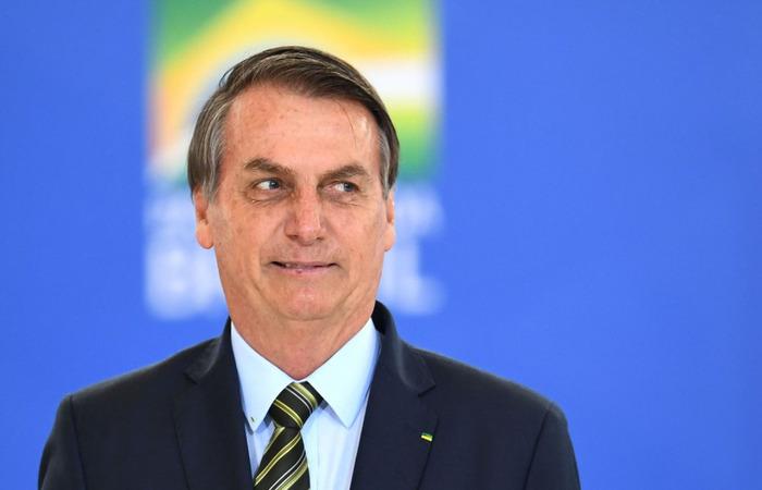 Mandatário, contudo, distorceu a fala da chanceler alemã, que relatou que o ato deveu-se ao pouco tempo de implementação das medidas restritivas  (Foto: Evaristo Sá/AFP)